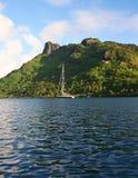 Vaimiti at Bora Bora. Photo of our sailing yacht Vaimiti moored in front of Bora Bora's lush mountains Stock Photo