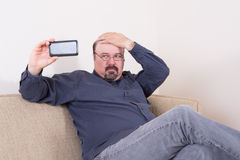 Vain man taking a selfie on his smartphone Stock Image