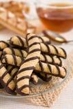 Vainilla y galletas y té del chocolate Fotografía de archivo libre de regalías