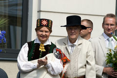 Vaira Vike-Freiberga - Ex-President of the Republi. Ex-President of the Republic of Latvia Vaira Vike-Freiberga and her husband wearing traditional costume Stock Photography