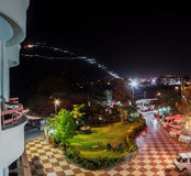Vaishnodevi hiking trail at night. Vaishnodevi, Katra, the famous pilgrimage trail on the mountain trail at night lit up with lights. View from a hotel at night royalty free stock image