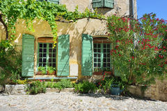 Vaison la Romaine, Provence, France. France, Provence. Vaison la Romaine. Typical medieval houses decorated with green plant and flowers in pots Royalty Free Stock Photos