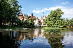 Vajdahunyad Castle in Budapest. HUNGARY, BUDAPEST - MAY 20, 2018: View on the Vajdahunyad Castle with beautiful lake in the City Park. This castle was built royalty free stock images
