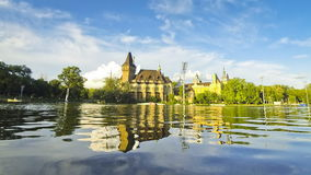 Vajdahunyad castle in Budapest. Vajdahunyad castle view from lakeside. Budapest, Hungary (Time Lapse stock video footage