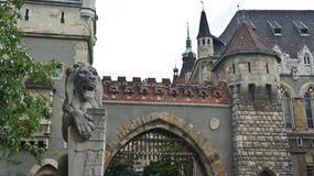 Entrance to Vajdahunyad Castle, statues of lion, beautiful architecture, Budapest, Hungary. Vajdahunyad Castle, statues of lion, Budapest Hungary royalty free stock images