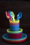 Vajilla plástico coloreado Fotografía de archivo