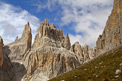 Vajolet Towers (Catinaccio group). The dolomitic peaks of Vajolet Towers stand out against summer sky Stock Photos