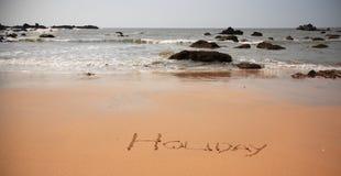 Vakantie die in het zand wordt geschreven Stock Fotografie