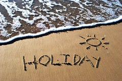 Vakantie die in zand wordt geschreven Stock Foto