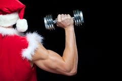 Vakantie en vieringen, Nieuw jaar, Kerstmis, sporten, het bodybuilding, gezonde levensstijl - Spier knappe Santa Claus stock foto
