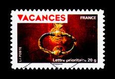 Vakantiezegels - Klopper op rode deur, Vakantie serie, circa Stock Foto
