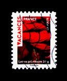Vakantiezegels - Rode tulband, Vakantie serie, circa 2009 Stock Foto's