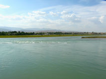 The Vakhsh River. In the city of Kurgan-tube Tajikistan Royalty Free Stock Photography