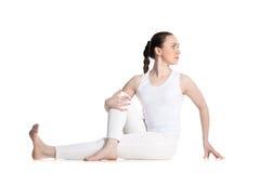 Vakrasana yoga pose Stock Photos