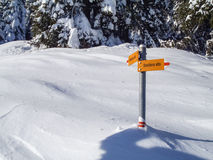 Val Blenio. Signposts on the path in the snow Royalty Free Stock Photos