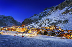 Val d'Isère city. Famous and luxury place of Val d'Isere at sunset, Tarentaise, Alps, France Royalty Free Stock Photo