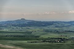 Val D ` Orcia的一个意想不到的看法在日落的从皮恩扎 免版税库存图片