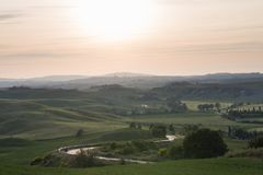 Val d`Orcia also called Valdorcia landscape in Tuscany at sunset. A very popular travel destination in Italy. Val d`Orcia or Valdorcia landscape in Tuscany at royalty free stock photos