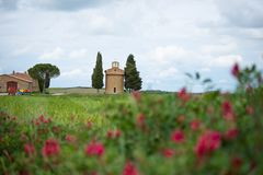 The church of Vitaleta. Val d`Orcia landscape in spring. Hills of Tuscany. Val d`Orcia, Siena, Tuscany, Italy - May, 2019 stock photos