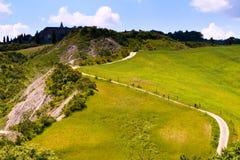 Val d& x27; Orcia, Siena, Tuscany, Włochy - wycieczka w rowerze górskim Fotografia Royalty Free
