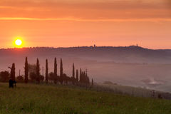 Val d'Orcia at sunset with photographer, Italy Royalty Free Stock Image