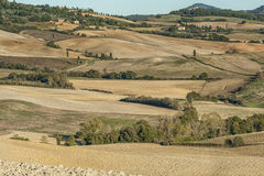 VAL D`ORCIA, TUSCANY-ITALY, OCTOBER 30, 2016: Scenic Tuscany landscape with rolling hills and valleys in autumn Stock Images