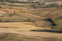 VAL D`ORCIA, TUSCANY-ITALY, OCTOBER 30, 2016: Scenic Tuscany landscape with rolling hills and valleys in autumn Royalty Free Stock Photos