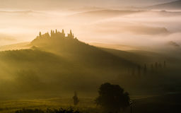 Val d'Orcia in Tuscany, Italy. Sunrise over Val d'Orcia in Tuscany, Italy Stock Photo