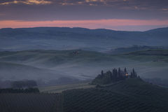 Val d'Orcia, Tuscany. Stunning view at sunrise of Podere Belvedere, the most famous location in San Quirico d'Orcia, Val d'Orcia, Tuscany. Italian landscape Stock Photo