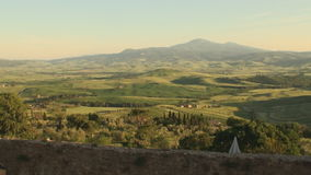 Val d'Orcia in Tuscany at sunset. Pan of Val d'Orcia in the province of Siena in Tuscany, Italy at sunset stock video