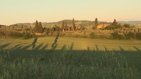 Val d'Orcia in Tuscany at sunset. Val d'Orcia in the province of Siena in Tuscany, Italy at sunset stock video footage