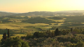 Val d'Orcia in Tuscany at sunset. Val d'Orcia in the province of Siena in Tuscany, Italy at sunset stock video