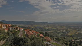 Val di Chiana, Italy. Time lapse clouds over Cortona in Tuscany stock footage
