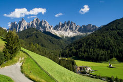 Val di Funes. Valley of Funes (Villnoss) with the Odle mountains in the background, Dolomites, Italy royalty free stock image