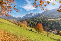 Val di Funes in the Dolomites in a autumn sunny day with colored trees, leafs and mountains, Trentino Alto Adige, Italy. Autumn colors in Val di Funes, near stock images