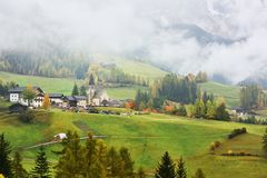 Val di Funes in fog, Dolomites, Italy Stock Images