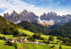 Val di Funes, Trentino Alto Adige, Italy. The great autumnal col. Ors shines under the late sun with Odle on the background and Santa Magdalena Village on the stock image