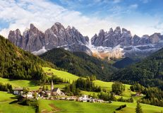 Val di Funes, Trentino Alto Adige, Italy. The great autumnal col. Ors shines under the late sun with Odle on the background and Santa Magdalena Village on the royalty free stock photo
