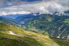 Valais Anniviers valley. Beautiful alpine meadow in summer with vibrant flowers on a mountain in the swiss alps near Grimentz, Switzerland, region Valais royalty free stock image