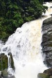 Valara Waterfalls in Kerala, India - Ledge Waterfall with Huge Stones in Green Forest. This is a photograph of Valara waterfall in Kerala, India... The waterfall Stock Photo