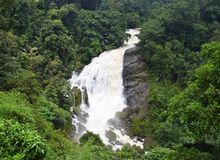 Valara Waterfalls in Thick Forest in Idukki, Kerala, India - Natural Landscape Wallpaper. This is a photograph of Valara waterfall in Kerala, India... The Royalty Free Stock Photos
