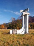 Valasky monument, Terchova, Slovakia. Autumn view portraying concrete monument of Valasky, type of Slovakian folk axes. This monument is located near Terchova Stock Image