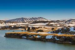 Valcano mount and lake in Myvatn Winter landscape royalty free stock image