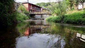 Valcarce river in Ambasmestas, León stock footage