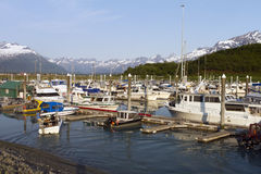 Valdez harbor. June 26, 2013 Valdez (AK, USA) boats returning to harbor after day of fishing Royalty Free Stock Photo