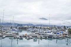 Valdez Harbor - Alaska. Valdez harbor, located in Valdez, Alaska, holds many vessels bound for fishing adventures, and leisure activities. The cold waters of royalty free stock photos