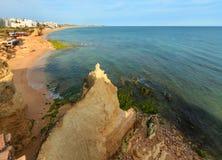 Vale do Olival BeachLagoa, Portugal. Vale do Olival Beach and Porches town summer view. Atlantic coast landscape Lagoa, Algarve, Portugal. People are Stock Image