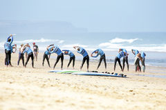 VALE FIGUEIRAS, PORTUGAL - August 16 2014:  Surfers doing excers. Ises on the famous surfers beach Vale Figueiras in Portugal Stock Photo