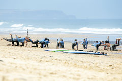 VALE FIGUEIRAS, PORTUGAL - August 16 2014:  Surfers doing excers. Ises on the famous surfers beach Vale Figueiras in Portugal Stock Image
