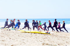 VALE FIGUEIRAS, PORTUGAL - August 20 2014: Surfers doing excersi Royalty Free Stock Photography